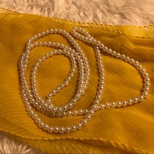 Long faux pearl necklace you can double or triple